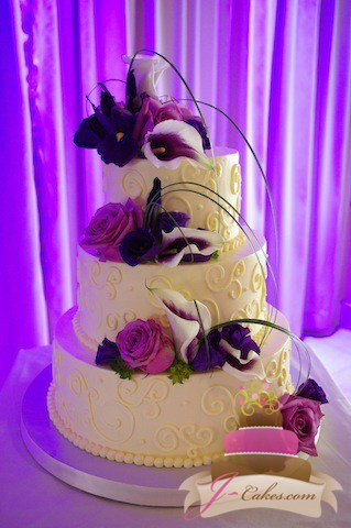 (1035) Variety of Scrolls Wedding Cake with Looped Bear Grass