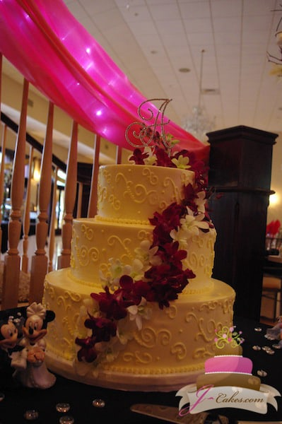 (1011) Variety of Scrolls Wedding Cake with Floral Cascade